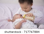 the portrait of brother and... | Shutterstock . vector #717767884