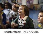 kindergarten students sitting... | Shutterstock . vector #717772906