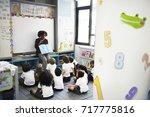 kindergarten students sitting... | Shutterstock . vector #717775816