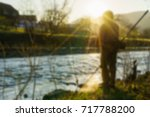 fishing on the river blurred... | Shutterstock . vector #717788200