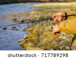 fishing on the river blurred... | Shutterstock . vector #717789298