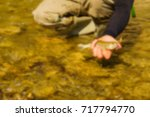 trout fishing in a mountain... | Shutterstock . vector #717794770