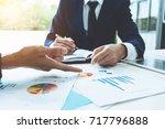business advisor analyzing... | Shutterstock . vector #717796888