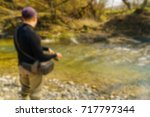 trout fishing in a mountain... | Shutterstock . vector #717797344