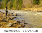 trout fishing in the mountain... | Shutterstock . vector #717797368