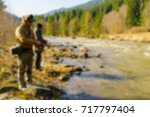trout fishing in the mountain... | Shutterstock . vector #717797404