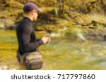 trout fishing in a mountain... | Shutterstock . vector #717797860