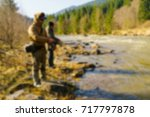 trout fishing in the mountain... | Shutterstock . vector #717797878