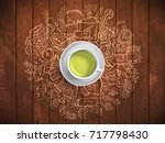 realistic cup of green tea with ... | Shutterstock .eps vector #717798430