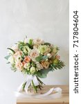 Small photo of Bridal bouquet. A simple bouquet of flowers and greens