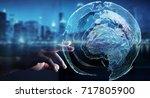 businessman touching global... | Shutterstock . vector #717805900