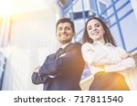 the happy man and woman stand... | Shutterstock . vector #717811540