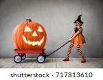 funny child dressed witch... | Shutterstock . vector #717813610