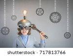 smart kid in classroom. child...   Shutterstock . vector #717813766