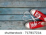 A Pair Of Red Retro Sneakers O...