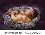 newborn baby sleeping in a... | Shutterstock . vector #717820420