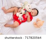 baby asia sleepping with her... | Shutterstock . vector #717820564