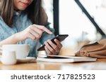 hand of woman using smartphone... | Shutterstock . vector #717825523