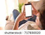 young man watching multimedia... | Shutterstock . vector #717830020