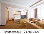 interior of a hotel bedroom | Shutterstock . vector #717832528
