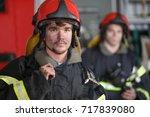 portrait of two heroic fireman... | Shutterstock . vector #717839080