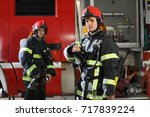 two firefighters in protective... | Shutterstock . vector #717839224