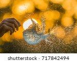 a water balloon bursting... | Shutterstock . vector #717842494