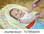 newborn baby boy in t shirt... | Shutterstock . vector #717856654