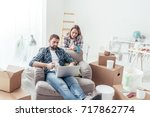 couple relaxing during home...   Shutterstock . vector #717862774