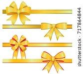 gold christmas bows on white... | Shutterstock .eps vector #717864844