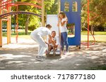 young family with adopted... | Shutterstock . vector #717877180