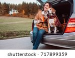 woman and dog with shawls sits...   Shutterstock . vector #717899359
