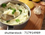 spoon with mashed potatoes over ... | Shutterstock . vector #717914989