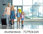 smiling family walking on... | Shutterstock . vector #717926164