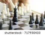Small photo of Business man woman play chess use King Chess Piece white to crash overthrow the competitor concept business strategy for win