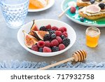 fresh ripe summer berries and... | Shutterstock . vector #717932758