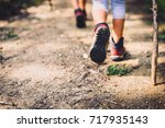 children hiking in mountains or ... | Shutterstock . vector #717935143