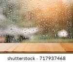 Wood Table Top On Rain Drops O...