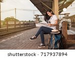 asian women backpack and hat at ... | Shutterstock . vector #717937894