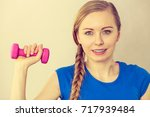 teenage young woman working out ... | Shutterstock . vector #717939484