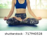 young asian woman practices... | Shutterstock . vector #717940528