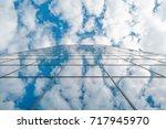modern business high rise glass ... | Shutterstock . vector #717945970