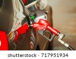 refueling gun in the car | Shutterstock . vector #717951934