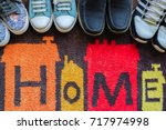 welcome home carpet with shoes... | Shutterstock . vector #717974998