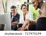 business people are discussing... | Shutterstock . vector #717975199