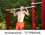 closeup of strong athlete doing ... | Shutterstock . vector #717986968
