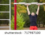 closeup of strong athlete doing ... | Shutterstock . vector #717987100