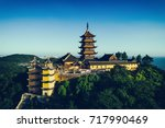 jiming temple sits atop a hill... | Shutterstock . vector #717990469