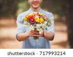 a young man is holding a... | Shutterstock . vector #717993214