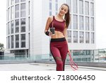 fitness sporty woman during... | Shutterstock . vector #718006450